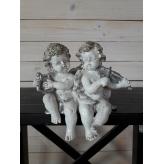 Párik sediacich anjelikov, dekorácia